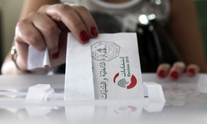 A woman casts her ballot at a polling station during the country's municipal elections in Beirut