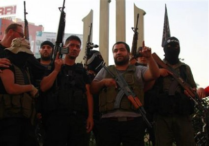 Sunni Muslim gunmen, hold up their weapons as they roam the streets, expressing solidarity with Salafist leader Ahmad al-Assir in Tripoli, northern Lebanon