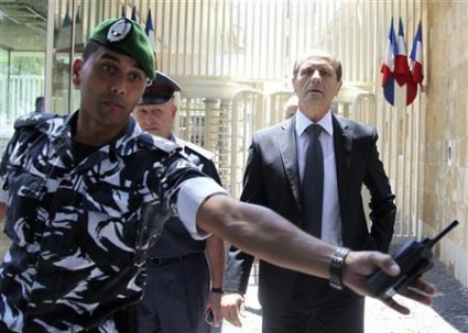 A Lebanese policeman paves the way for Lebanon's Interior Minister Charbel in Beirut