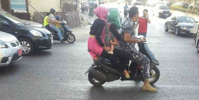 Families on Scooters in Lebanon: A Double Hazard