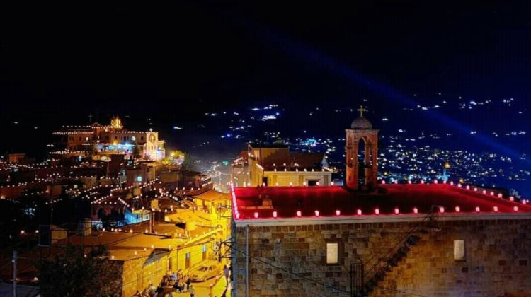 11,000 Candles Light Up Bkaakafra on St. Charbel's Feast Day